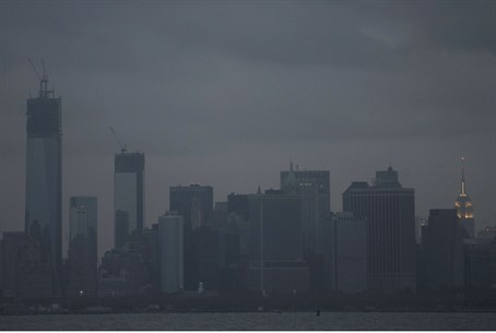 The skyline of lower Manhattan sits in darkne