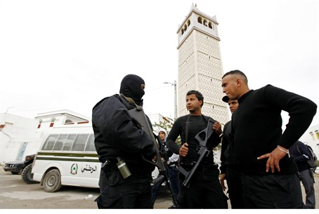 Tunisian police on guard outside mosque in Tu