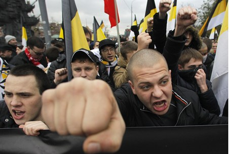 Russian nationalists shout as they attend a ""