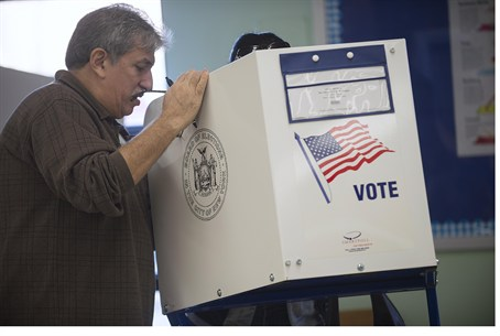 Poll worker helps voter in Staten Island, NY