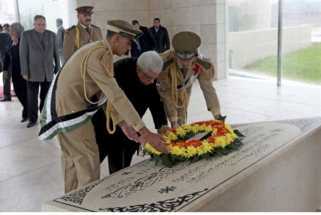 PA Chairman Mahmoud Abbas lays a wreath on gr