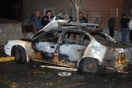 Car Hit by Terrorists' Rocket