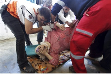 Medics with Gaza woman