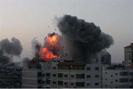 An explosion and smoke are seen after Israeli
