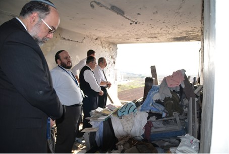Rabbis at Demolished Appartment