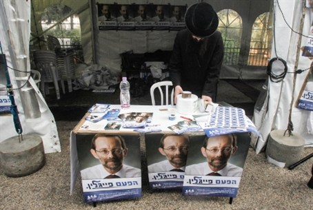 Likud supporter arrives in Jerusalem to vote