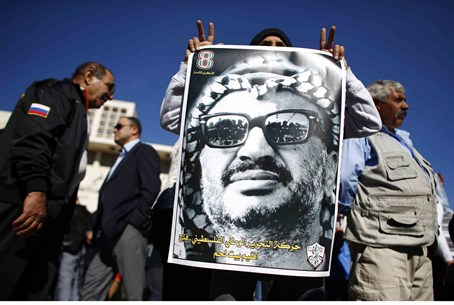 Arabs hold poster of terrorist Yasser Arafat