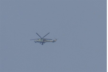 Syrian Army helicopter flies over Houla, near