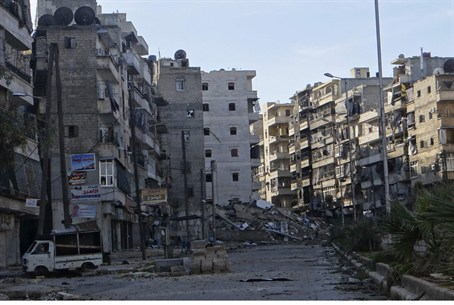 Damages on an empty street in the Aleppo dist