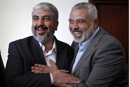 Ismail Haniyeh (R) with Hamas chief Khaled Ma