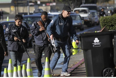 Police officers collect guns in California