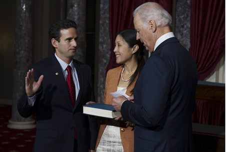 U.S. Senator Schatz stands with his wife whil