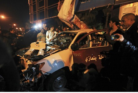 wreckage of a police car following Benghazi a