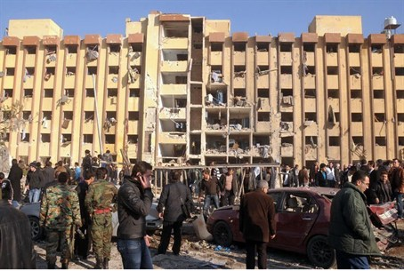Syrians gather at the scene of an explosion o