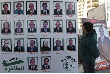 A man looks at electoral posters for parliame