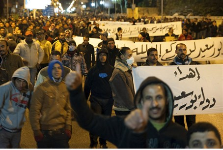 Protesters march during a nighttime curfew in