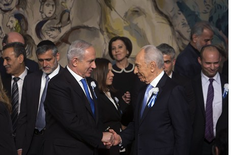 Israel's PM and President shake hands at the