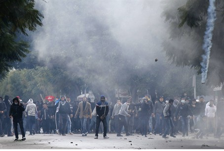 Protesters clash with riot police near the In
