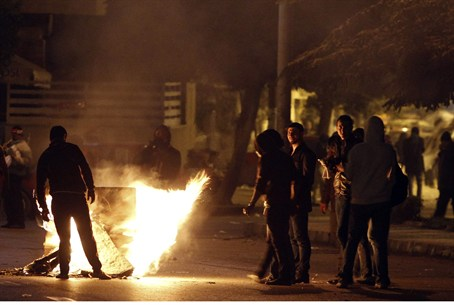 Anti-Morsi protesters during clashes with pol
