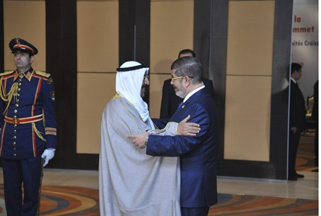 Egyptian President Mohamed Mursi greets Kuwai