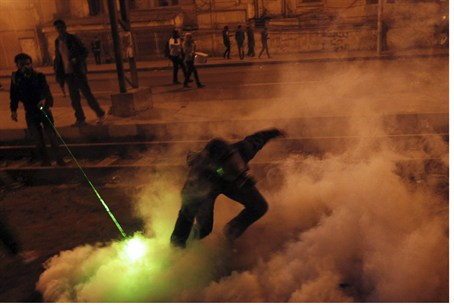 Anti-government protester hurls tear gas cann
