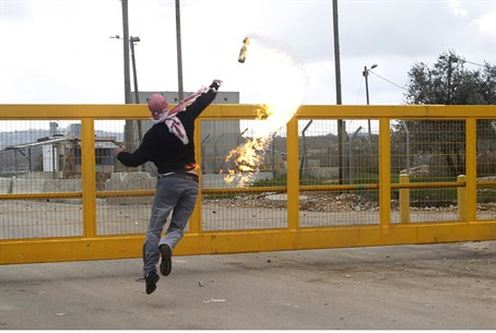 PA protester throws a Molotov cocktail toward