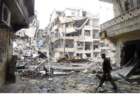 A debris-filled street in Aleppo