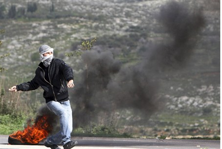 PA protester throws rocks towards Israeli for