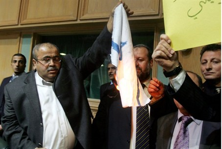Jordanian MP Khalil Atiyeh burns Israeli flag
