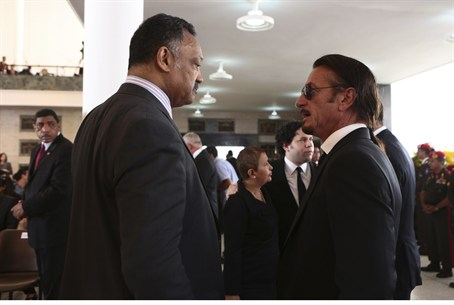 Rev. Jesse Jackson (L) talks with actor Sean
