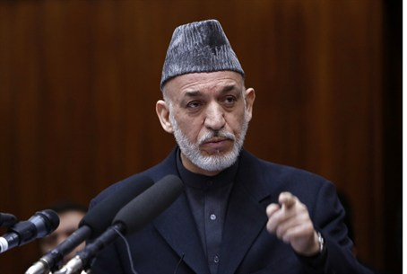 Afghan President Hamid Karzai ratcheted up hi