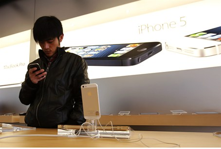 A visitor tries an iPhone at an Apple store