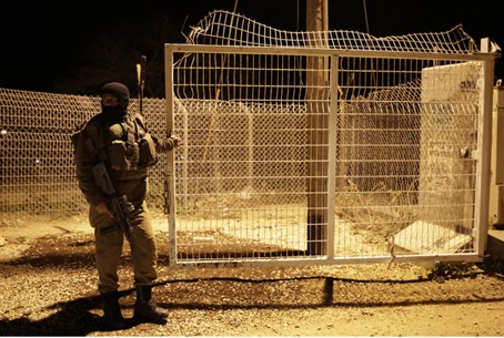 Soldier at Gaza security barrier