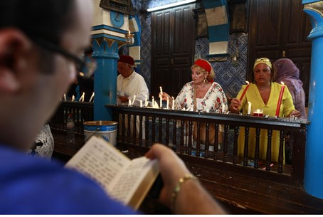 Jews pray inside the El Ghriba synagogue in D