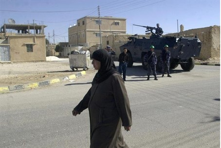 Jordanian woman walks through the streets of