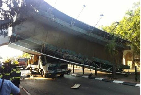 Truck smashed by falling walkway