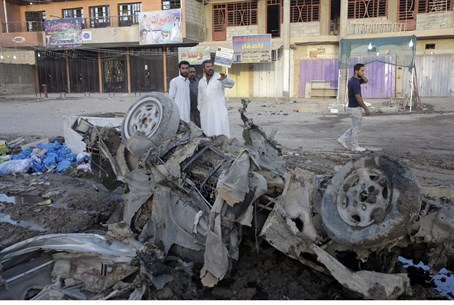 Aftermath of car bomb in Baghdad, August 2013