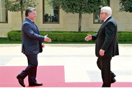 King Abdullah of Jordan, left, meets Mahmoud