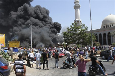 Smoke rises outside al-Taqwa mosque in Tripol