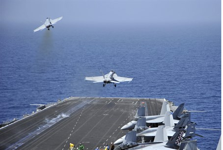 F/A-18F Super Hornets launch from US Navy air