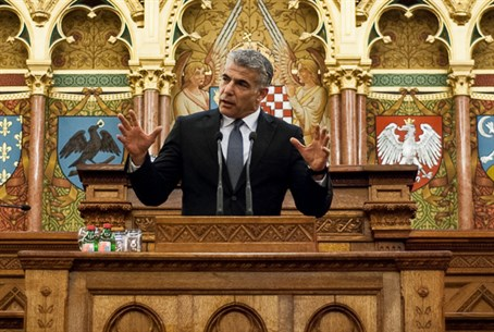 Lapid speaks in the Hungarian parliament