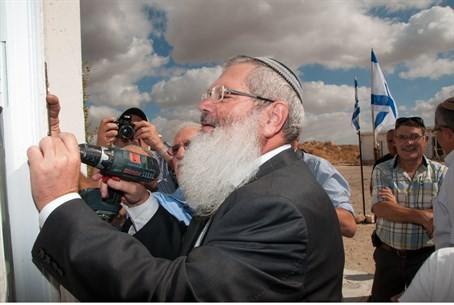 Rabbi Ben-Dahan affixes a mezuzah in Shdema