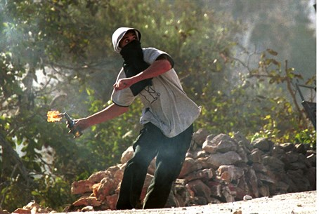 (Illustration) Arab rioter throws firebomb