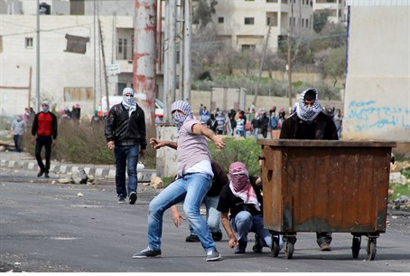 Arab rioters throwing rocks (Illustrative)