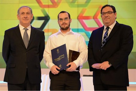 Bible contest winner (center) with PM, Piron