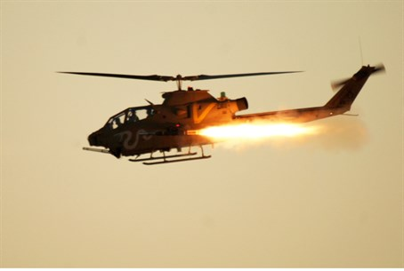 Illustration: IDF helicopter firing missile