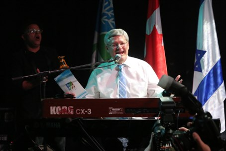 Harper plays the keyboard