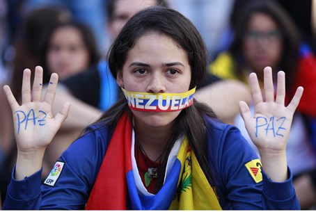 Venezuelan student at opposition rally in Car