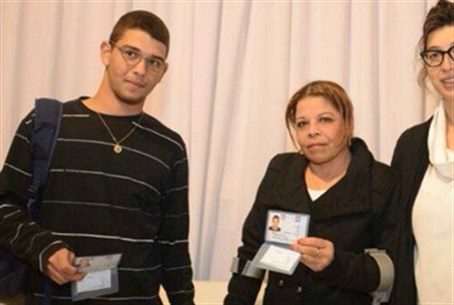 Rabin (L) and his mother, with ID cards