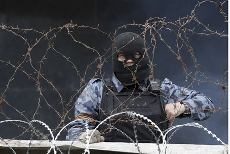 Pro-Russian militiaman behind a barricade at